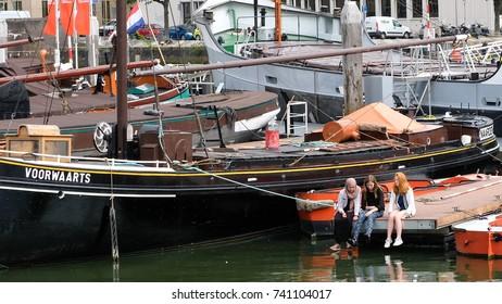 Rotterdam, The Netherlands - May 16, 2017. Three girls communicate on the berth of ships