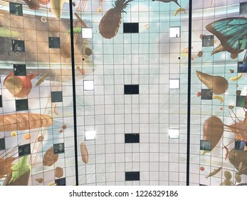 ROTTERDAM, THE NETHERLANDS - MAY 20, 2017: The colourful painted arch ceiling of the Markthal,  famous market hall in central Rotterdam on May 20, 2017.