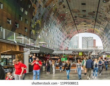 Rotterdam, Netherlands - May 22, 2018: People inside the huge horseshoe-shaped Markthal (Market Hall). The Markthal has about 100 fresh food stands, nearly 15 food shops and various restaurants.