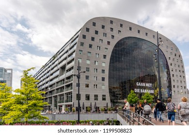 Rotterdam, Netherlands - May 22, 2018: The grey huge horseshoe-shaped building of Markthal (Market Hall) - residential and office building with a market hall underneath.