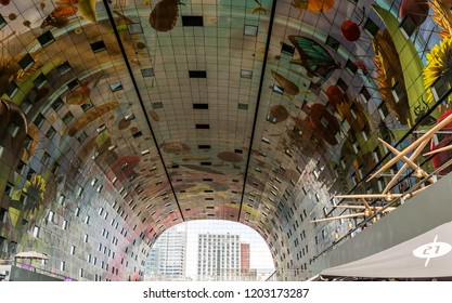 Rotterdam, Netherlands - May 22, 2018: The inside of the The Markthal (Market Hall) adorned with an artwork of strongly enlarged fruits, vegetables, seeds, fish, flowers and insects.