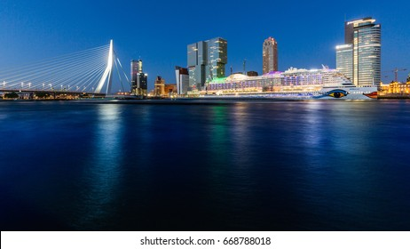 ROTTERDAM, NETHERLANDS - MAY 25, 2017: Exterior view of the Erasmus Bridge at sunset and the Maas River on May 25, 2017. The bridge is named after Desiderius Erasmus and its second largest in Holland.
