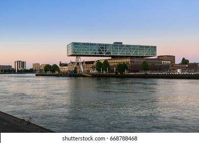 ROTTERDAM, NETHERLANDS - MAY 25, 2017: Exterior view of the promenade from the Prins Hendrikkade Street at evening with a view to the Maas River on May 25, 2017. With a view to the Unilever building.