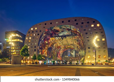 ROTTERDAM, NETHERLANDS - MAY 25, 2018: Markthal Market Hall residential and office building with a market hall underneath in Rotterdam designed by by architectural firm MVRDV illuminated in night