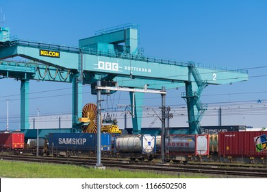 ROTTERDAM, NETHERLANDS - MAY 6, 2017: Crane loading containers on a train in the Rotterdam port area