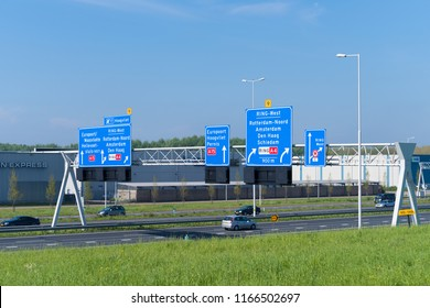 ROTTERDAM, NETHERLANDS - MAY 6, 2017: Directional highway road signs above the Rotterdam A15, a main highway in the harbor area