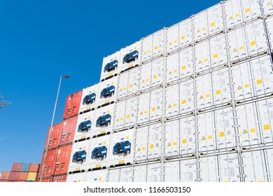 ROTTERDAM, NETHERLANDS - MAY 6, 2017: Piled up cargo containers in the Rotterdam harbor area