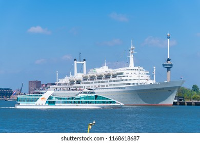 ROTTERDAM, NETHERLANDS - MAY 6, 2017: Tour boat in front of the SS Rotterdam, a former cruise ship of the Holland-America line