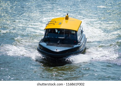 ROTTERDAM, NETHERLANDS - MAY 6, 2017: Water taxi speeding over the river. With about 50 departure locations it offers an often faster option for transportation within and outside the city.