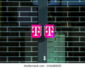 ROTTERDAM, NETHERLANDS - May 9, 19: T-Mobile logo on a door handle. T-Mobile is the brand name used by the mobile communications subsidiaries of the German telecommunications company Deutsche Telekom