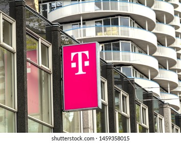 ROTTERDAM, NETHERLANDS - May 9, 19: T-Mobile logo on a store. T-Mobile is the brand name used by the mobile communications subsidiaries of the German telecommunications company Deutsche Telekom