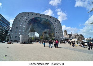 Rotterdam, Netherlands - May 9, 2015: People visit Markthal (Market hall) a new icon in Rotterdam. The covered food market and housing development shaped like a giant arch by Dutch architects MVRDV.
