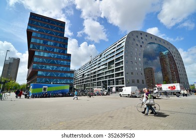 Rotterdam, Netherlands - May 9, 2015: People visit Market hall near blaak station in Rotterdam. The covered food market and housing development shaped like a giant arch by Dutch architects MVRDV.