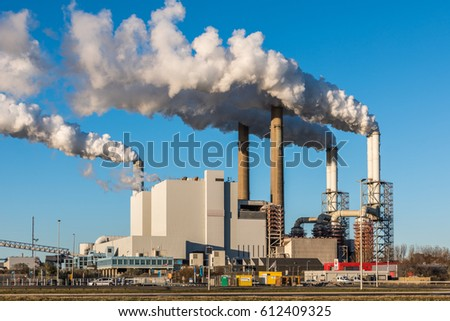 ROTTERDAM, THE NETHERLANDS - NOVEMBER 28, 2016: The Uniper coal power plant in full operation with smoking chimneys at the Maasvlakte near Rotterdam in the Netherlands.