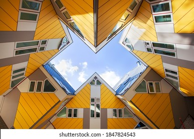 Rotterdam, Netherlands – November 4, 2020: Yellow cubic houses or kubuswoningen by architect Piet Blom on the Blaak in Rotterdam