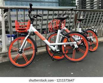 Rotterdam, the Netherlands - October 23, 2018: Two Mobike's parked next to a fence in the Dutch city of Rotterdam.  Mobike is a bicycle sharing system.