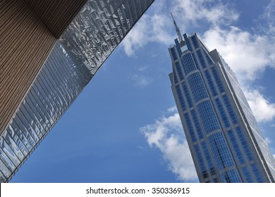ROTTERDAM, THE NETHERLANDS - OCTOBER 25, 2015: The Millennium Tower against a blue sky and white cumulus clouds. The Millennium Tower is a 35-storey skyscraper in Rotterdam (The Netherlands).