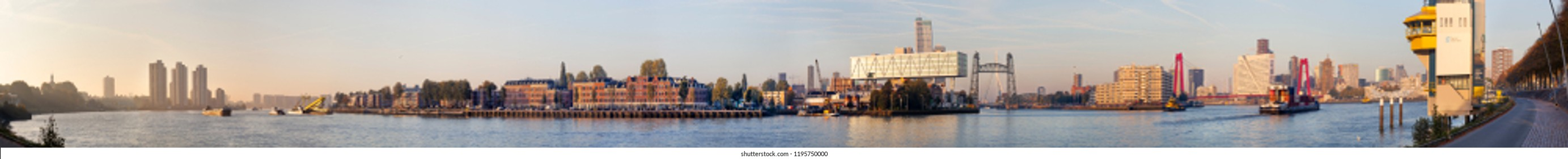Rotterdam, Netherlands – October 5, 2018: Panorama of Rotterdam with the center of the city on the right side and the south district on the left side of the river Meuse