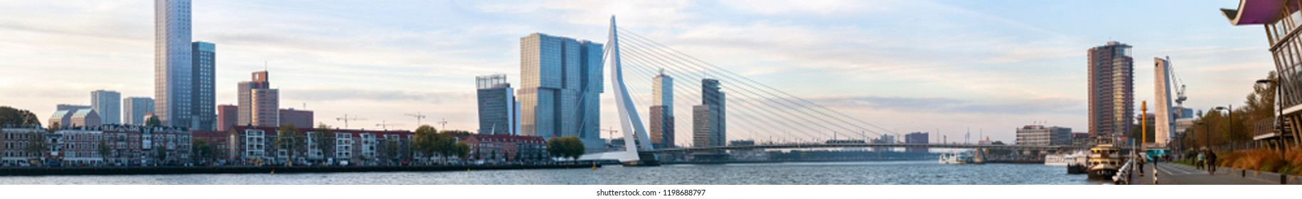 Rotterdam, Netherlands – October 9, 2018: Panorama of Rotterdam awakening in the early morning with the Erasmus bridge connecting the south with the north