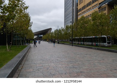 Rotterdam, The Netherlands, Oktober 26, 2018: Cloudy day at Rotterdam central station. with a tram in foreground and people