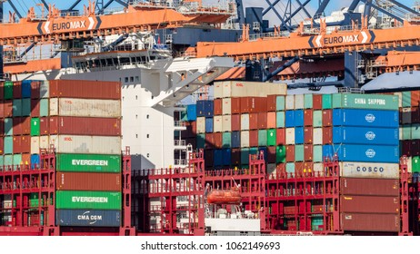ROTTERDAM, THE NETHERLANDS - SEP 2, 2017: Container ship being loaded by gantry cranes in the Maasvlakte in the Port of Rotterdam.