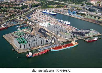 ROTTERDAM, THE NETHERLANDS - SEP 2, 2017: Aerial view of a oil and container terminal with moored ships in the Port of Rotterdam.