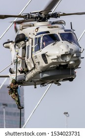 ROTTERDAM, NETHERLANDS - SEP 3, 2016: Anti-piracy demonstration with Dutch marines entering a vessel from a NH90 helicopter during the World Harbor Days in Rotterdam.