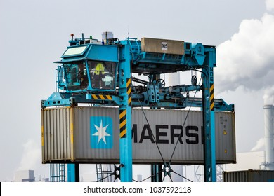 ROTTERDAM, NETHERLANDS - SEP 6, 2013: Straddle carrier moving a Maersk container in the shipping terminal of the Port of Rotterdam.