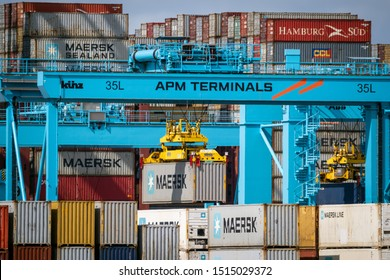 ROTTERDAM, THE NETHERLANDS - SEP 8, 2019: Shipping containers are moved in the APM Terminal in the new Maasvlakte 2 in the Port of Rotterdam.