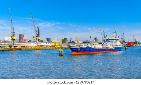 Rotterdam / The Netherlands - Sept. 26, 2018: Ocean going vessels in the busy Waalhaven, a branch of the arbor of Rotterdam, one of the main ports for goods entering and leaving the European continent