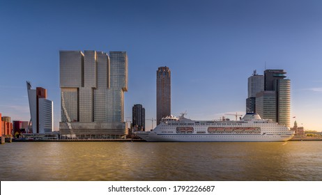 Rotterdam / The Netherlands - Sept. 26, 2018: Modern architectural High Rise buildings and a Cruise Ship at the Holland Amerikakade cruise terminal at the Nieuwe Maas River in Rotterdam