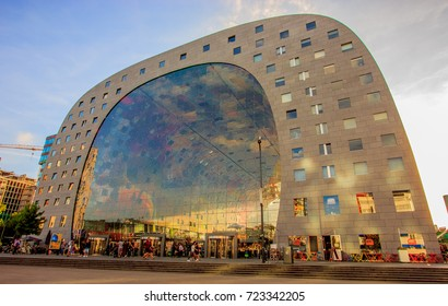 Rotterdam, Netherlands - September 01, 2016: People at Rotterdam's Market Hall (Markthal), a covered market hall and apartment complex. The ceiling of the Markthal bears the world's largest artwork.
