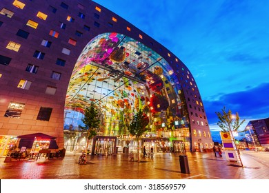 ROTTERDAM, NETHERLANDS - SEPTEMBER 03, 2015: modern market hall in Rotterdam at night. It was opened Oct 1, 2014 by Queen Maxima, designed by architect firm MVRDV. With unidentified people