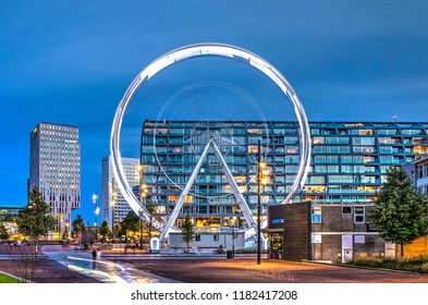 Rotterdam, The Netherlands, September 15, 2018: Binnenrotte square during the blue hour with the temporary Ferris wheel and the Markthal