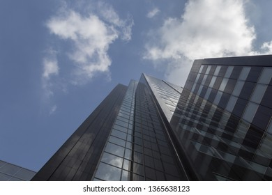 Rotterdam, The Netherlands - September 17, 2017: Reflection of the blue skay and the clouds in a building in Rotterdam Netherlands center