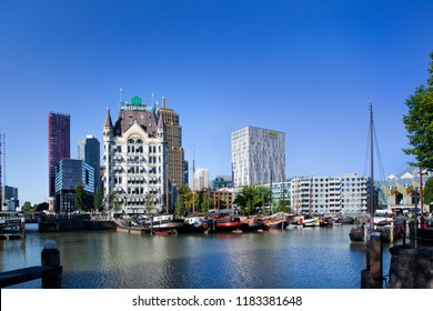 Rotterdam, Netherlands – September 18, 2018: Historical ships moored in the Oude Haven in Rotterdam with the Witte Huis or white house on the left and some famous cubic houses on the right