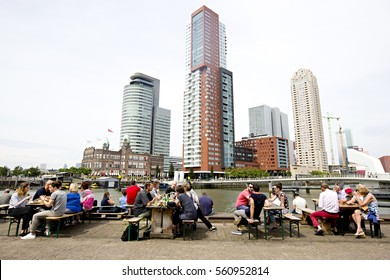 ROTTERDAM, THE NETHERLANDS - SEPTEMBER 2016: People enjoying the outside terraces of the Fenix Food Factory with the Rotterdam skyline in the background