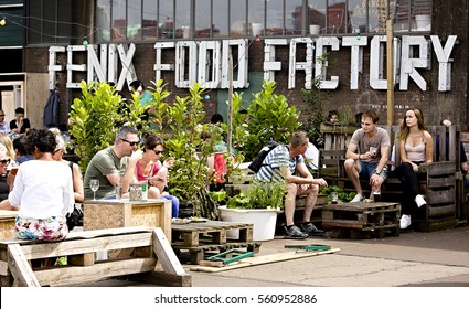 ROTTERDAM, THE NETHERLANDS - SEPTEMBER 2016: People enjoying the sun at the Fenix Food Factory in Katendrecht, Rotterdam