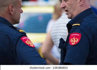ROTTERDAM, NETHERLANDS - SEPTEMBER 3, 2017: Two firefighters talking during the Rotterdam port days