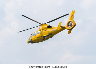 ROTTERDAM, NETHERLANDS - SEPTEMBER 3, 2017: Yellow offshore rescue helicopter doing a demonstration during the Rotterdam world port days