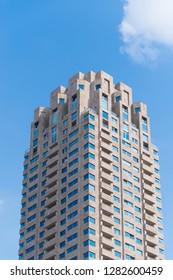 ROTTERDAM, NETHERLANDS - SEPTEMBER 3, 207: Modern residential tower against a blue sky