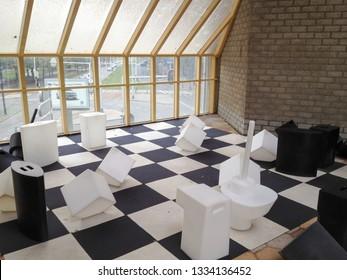 Rotterdam, Netherlands - September 7, 2013: innovative chess board in Schaakstukkenmuseum museum of chess pieces under Kubuswoningen Cube House