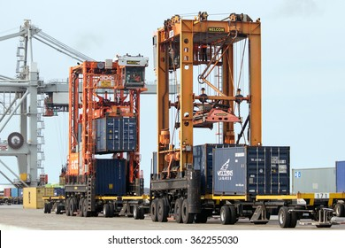 ROTTERDAM, NETHERLANDS - SEPTEMBER 8, 2013: Straddle carriers moving shipping containers in the Port of Rotterdam.