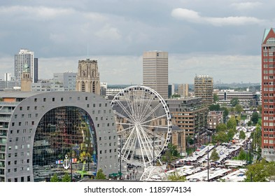 Rotterdam, The Netherlands, September 8, 2018: Aerial view of the Saturday market on Binnenrotte square, also featuring Markthal, Ferris wheel and Saint Lawrence church