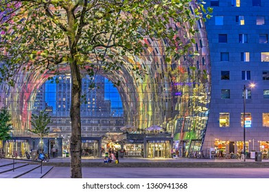 Rotterdam, The Netherlands, September 9, 2016: view through the colorful interior of Markthal, a mixed-use building with market and appartments, during the blue hour