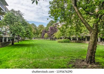 Rotterdam, The Netherlands, September 9, 2018: residential complex De Eendracht, national monument from the 1930's by architect J.H. van den Broek, seen through the garden towards Vroesenpark.