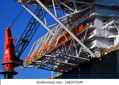 Rotterdam, The Netherlands-March 2020: Low angle close up view of escape boats offshore platform, largest crane vessel in the world (Sleipnir)