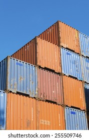ROTTERDAM - OCTOBER 4, 2014: Piled up cargo containers in the rotterdam port. It is the largest port in Europe, covering 105 square kilometers (41 sq miles)
