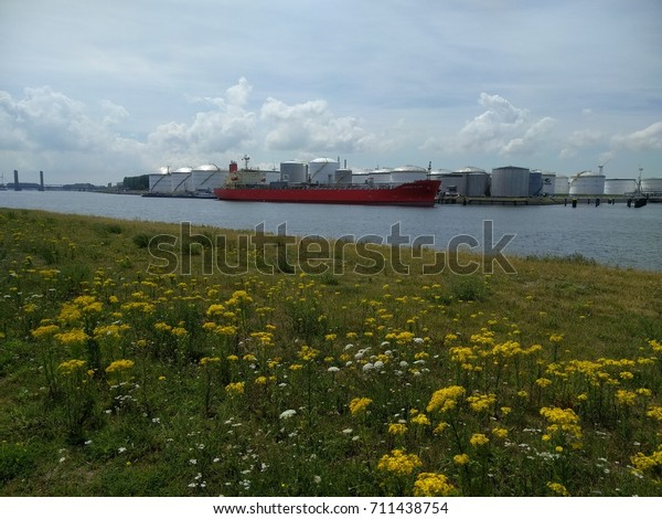 ROTTERDAM SEAPORT - JULY 2017: Tanker Caroni plain berthed at Europoort oil terminal, a busy port and major entry to Europe