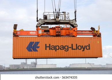 ROTTERDAM - SEP 6, 2015: Crane operator picking up a sea container in the Port of Rotterdam